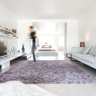 Inspiration for a modern living room remodel in New York with white walls