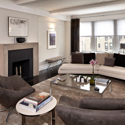 Example of a trendy living room design in New York with beige walls, a standard fireplace and no tv