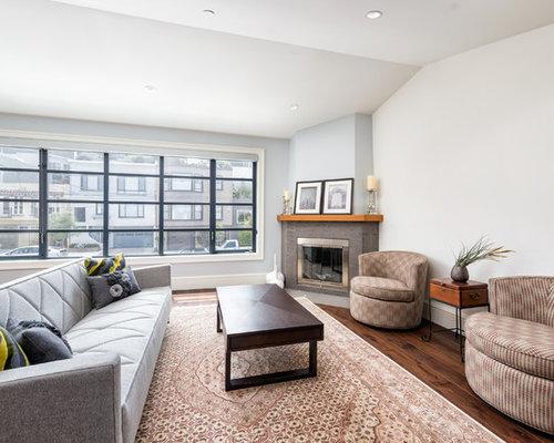 salon avec une chemin e d 39 angle et un mur multicolore photos et id es d co de salons. Black Bedroom Furniture Sets. Home Design Ideas