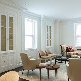 ニューヨークの広いエクレクティックスタイルのおしゃれなLDK (白い壁、フォーマル、無垢フローリング、標準型暖炉、石材の暖炉まわり、茶色い床) の写真