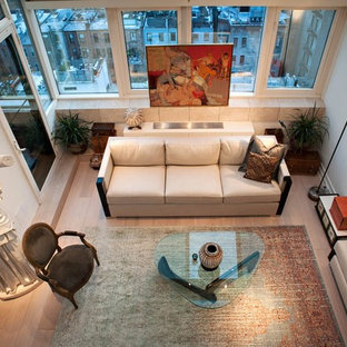 Living room - eclectic open concept light wood floor living room idea in New York with white walls, no fireplace and no tv