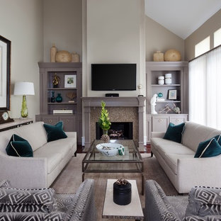 Living room - mid-sized transitional enclosed medium tone wood floor and brown floor living room idea in Minneapolis with beige walls, a standard fireplace, a wall-mounted tv and a stone fireplace
