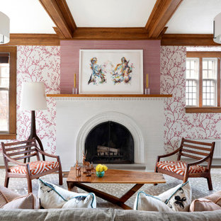 Living room - transitional medium tone wood floor, brown floor, exposed beam and wallpaper living room idea in Minneapolis with pink walls, a standard fireplace and a brick fireplace