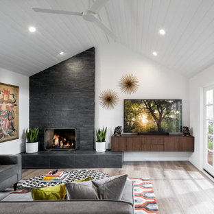 Inspiration for a large mid-century modern open concept gray floor and shiplap ceiling living room remodel in Orange County with white walls, a standard fireplace, a tile fireplace and a tv stand