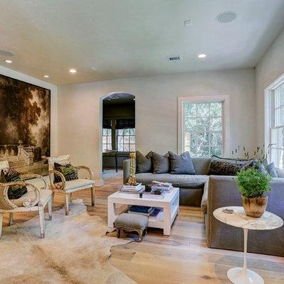 Cottage open concept light wood floor living room photo in Houston
