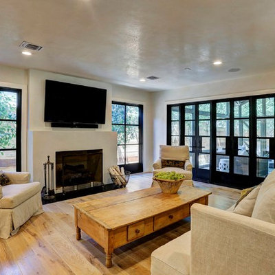 Example of a cottage open concept light wood floor living room design in Houston