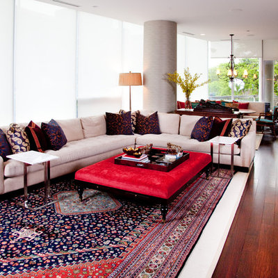Inspiration for an eclectic open concept red floor living room remodel in Chicago with a bar