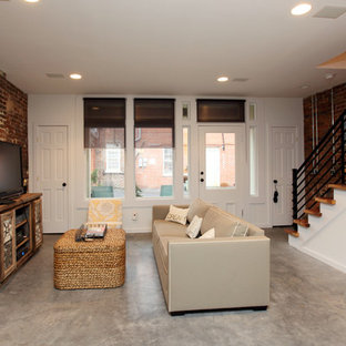 Example of a mountain style concrete floor living room design in Richmond with a wood stove