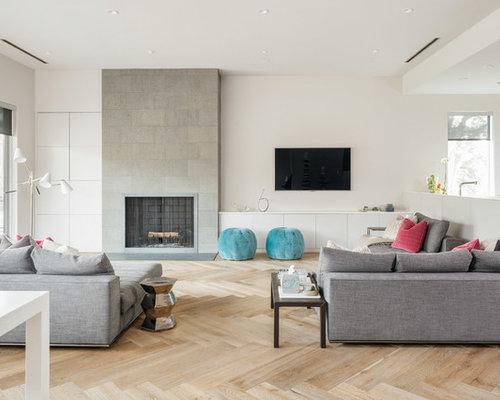 Danish Open Concept Living Room Photo In Houston With White Walls Light Hardwood Floors