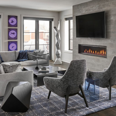 Large trendy open concept dark wood floor and brown floor living room photo in Chicago with gray walls, a tile fireplace, a wall-mounted tv and a ribbon fireplace