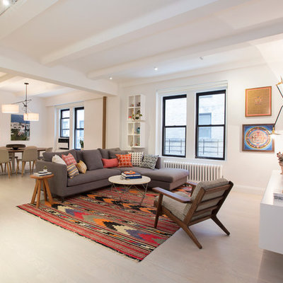Example of a large trendy formal and open concept living room design in New York with white walls and a wall-mounted tv