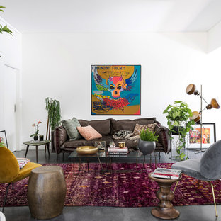 Eclectic formal open concept living room in Perth with white walls, concrete floors and black floor.