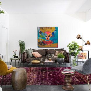 パースのエクレクティックスタイルのおしゃれなLDK (フォーマル、白い壁、コンクリートの床、黒い床) の写真