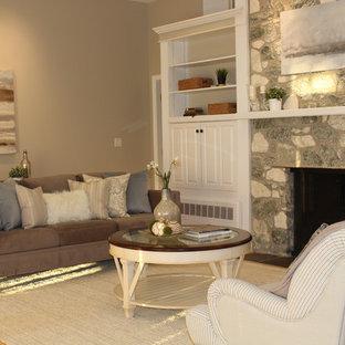 ボストンの大きいビーチスタイルのおしゃれなLDK (グレーの壁、淡色無垢フローリング、標準型暖炉、石材の暖炉まわり、内蔵型テレビ) の写真