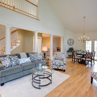 Mid-sized traditional open concept living room in Philadelphia with light hardwood floors.
