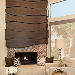 Foto di un soggiorno design con pareti beige, camino ad angolo, cornice del camino piastrellata e sala formale