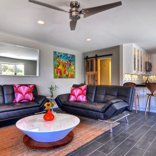 Island style gray floor living room photo in Orange County with gray walls