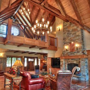 Idées déco pour un salon montagne avec une salle de réception, une cheminée standard et un manteau de cheminée en pierre.