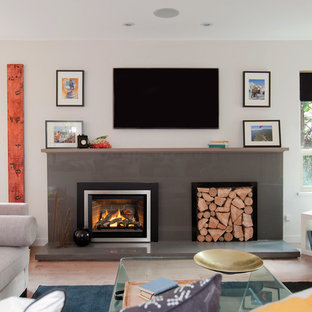 Inspiration for a mid-sized eclectic open concept light wood floor living room remodel in Portland with white walls, a standard fireplace, a concrete fireplace and a wall-mounted tv