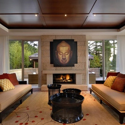 Example of an asian formal and enclosed dark wood floor and brown floor living room design in Calgary with beige walls, a standard fireplace, a stone fireplace and no tv