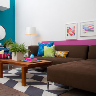 Example of a minimalist living room design in Los Angeles with blue walls