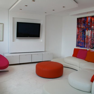 Mid-sized minimalist marble floor living room photo in Miami with white walls, no fireplace and a wall-mounted tv