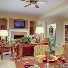 Traditional Living Room by timberland homes inc.