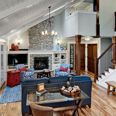 Large mountain style living room photo in Minneapolis with white walls, a standard fireplace and a stone fireplace