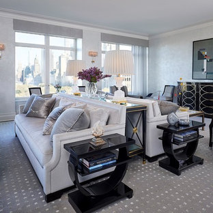 Living room - large transitional loft-style carpeted living room idea with white walls