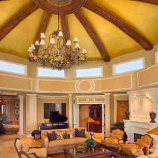 マイアミの地中海スタイルのおしゃれなリビング (フォーマル、標準型暖炉、テレビなし、ベージュの壁、大理石の床、石材の暖炉まわり) の写真
