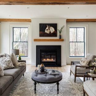 ボストンの広いカントリー風おしゃれなリビング (白い壁、淡色無垢フローリング、標準型暖炉、金属の暖炉まわり、テレビなし、フォーマル、表し梁) の写真