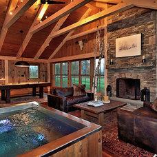 Rustic Living Room by Blansfield Builders, Inc.