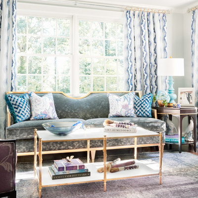 Example of a classic formal living room design in Other with gray walls and no fireplace