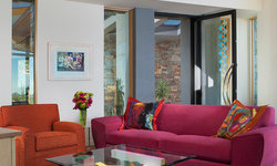 Vibrant colors of orange and hot pink with white walls and wood ceilings