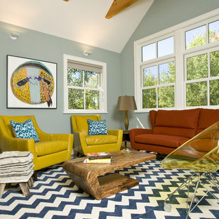 Example of an eclectic enclosed living room design in Other with blue walls
