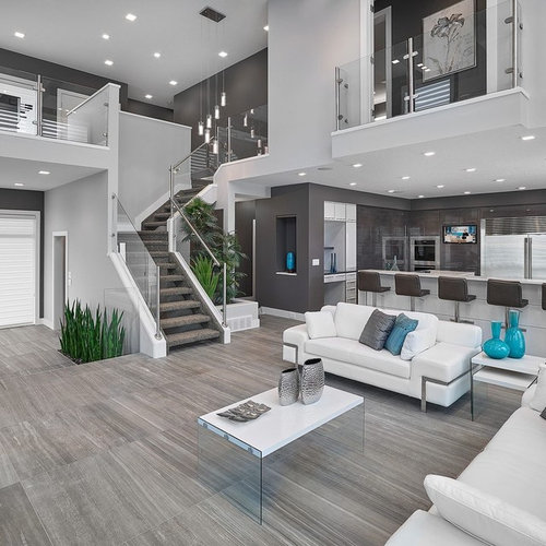Inspiration For A Contemporary Open Concept Living Room Remodel In Edmonton With Gray Walls And