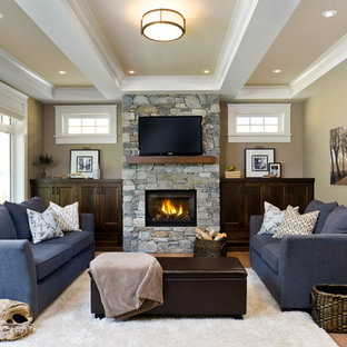 Living room - traditional enclosed medium tone wood floor living room idea in Vancouver with beige walls, a standard fireplace, a stone fireplace and a wall-mounted tv