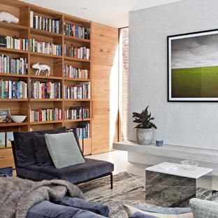 Ejemplo de biblioteca en casa cerrada, actual, de tamaño medio, con suelo de cemento, paredes blancas y suelo blanco