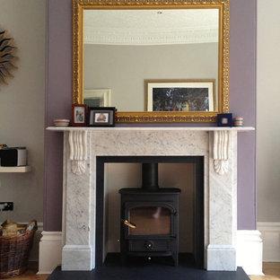 Großes, Repräsentatives, Abgetrenntes Klassisches Wohnzimmer mit lila Wandfarbe und hellem Holzboden in Cheshire