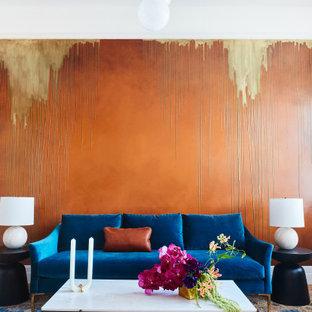 サンフランシスコの中サイズのエクレクティックスタイルのおしゃれな独立型リビング (フォーマル、オレンジの壁、無垢フローリング、暖炉なし、テレビなし) の写真