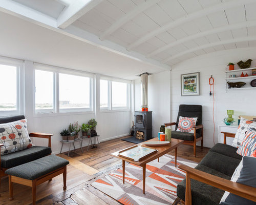 Inspiration For A Scandinavian Living Room In London With White Walls,  Medium Hardwood Flooring And