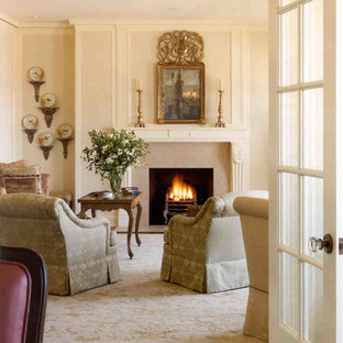 Design ideas for a mid-sized victorian formal enclosed living room in San Francisco with beige walls, medium hardwood floors, a standard fireplace, a stone fireplace surround and no tv.