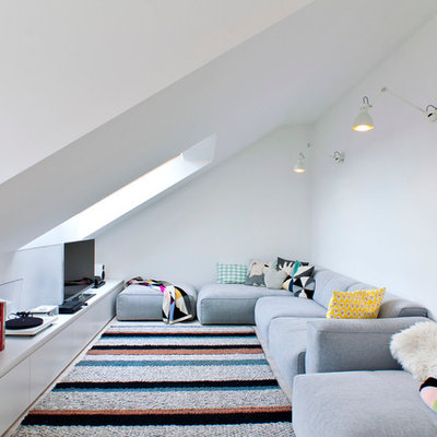 Living room - scandinavian formal and enclosed living room idea in Other with white walls and a tv stand