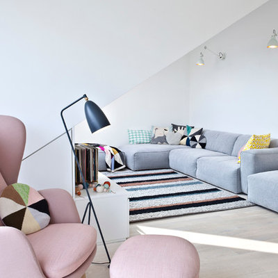 Living room - scandinavian formal light wood floor living room idea in Other with white walls