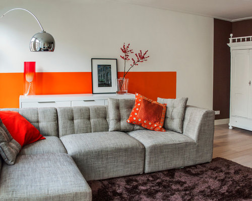 Minimalist Beige Floor Living Room Photo In Amsterdam With Orange Walls
