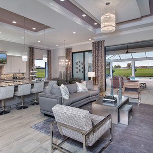 Design ideas for a contemporary open plan living room in Miami with grey walls, a wall mounted tv and grey floors.