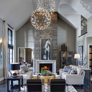 Example of a transitional open concept dark wood floor living room design in Detroit with gray walls