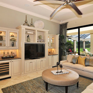 Inspiration for a traditional living room in Miami with beige walls and a freestanding tv.