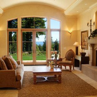 サンフランシスコの中くらいの地中海スタイルのおしゃれなLDK (フォーマル、ベージュの壁、ライムストーンの床、標準型暖炉、石材の暖炉まわり、テレビなし) の写真