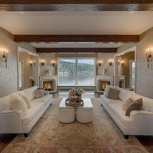 ポートランドの大きい地中海スタイルのおしゃれな独立型リビング (フォーマル、ベージュの壁、無垢フローリング、コーナー設置型暖炉、石材の暖炉まわり、茶色い床) の写真